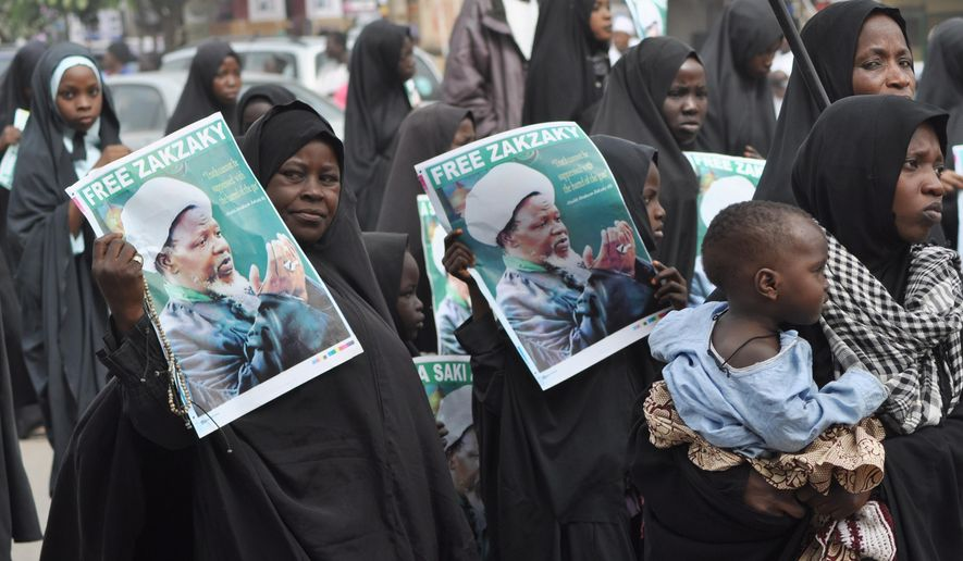 Nigeria shiites muslim took to the street to protest and demanded the release of Shiite leader Ibraheem Zakzaky in Kano, Nigeria, Monday, Dec. 21, 2015.  Hundreds of Shiites were reportedly killed in an army raid in Nigeria last Saturday. (AP Photo/Muhammed Giginyu)