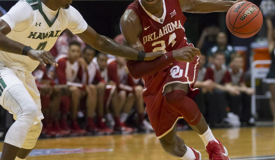 Oklahoma guard Buddy Hield (24) attempts to get by Hawaii guard Isaac Fleming during the first half of an NCAA college basketball game at the Diamond Head Classic, Wednesday, Dec. 23, 2015, in Honolulu. (AP Photo/Eugene Tanner)