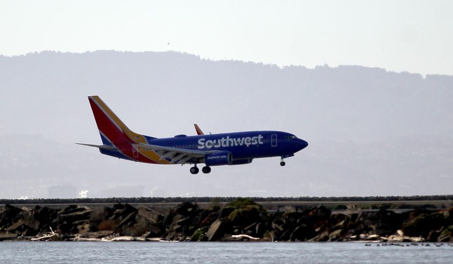 Southwest Airlines Flight 2547 makes an emergency landing after circling for several hours at Oakland International Airport in Oakland, Calif., on Wednesday, Dec. 23, 2015. The flight made what appeared to be a normal landing after circling for several hours over an Oakland, California, airport due to possible landing gear problems. (Anda Chu/Bay Area News Group via AP) STAND ALONE NEWS/LOCALS PLEASE CREDIT/MAGS OUT
