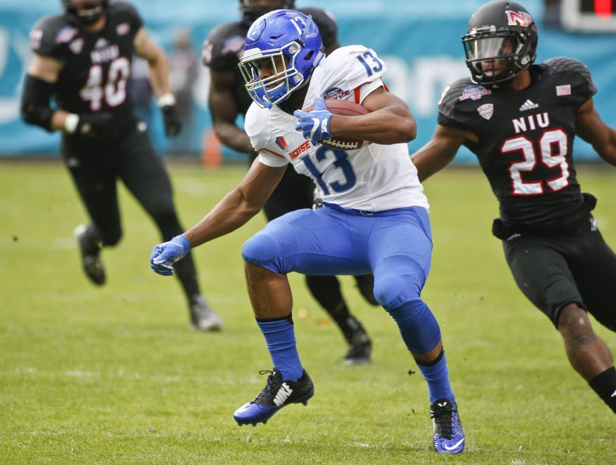 Boise State running back Jeremy McNichols maneuvers through the Northern Illinois defense with a pass reception during the first half of the Poinsettia Bowl NCAA college football game Wednesday, Dec. 23, 2015, in San Diego. (AP Photo/Lenny Ignelzi)
