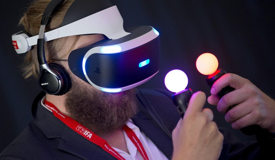 FILE - In this Sept. 2, 2015 file photo, a man tests a Sony 'Project Morpheus Virtual Reality' device after a press conference at the company's stand at the IFA 2015 tech fair in Berlin, Germany.  If you're a gamer, the appeal of immersing yourself in a virtual world might be obvious. Strap on a headset and you could find yourself in a three-dimensional death match with opponents who could - almost literally - creep up right behind you. Many leading companies are betting on VR with more sophisticated headsets are on their way. Sony's PlayStation VR - formerly Project Morpheus - won't need a phone and attaches to a PlayStation game console.  (AP Photo/Michael Sohn, File)