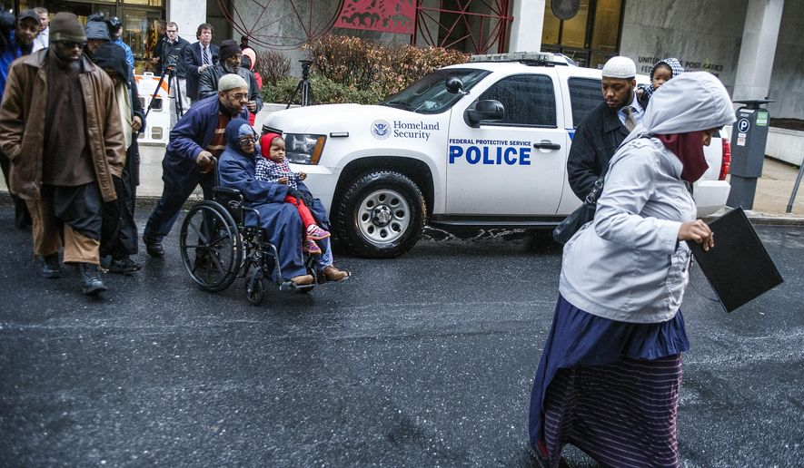 Supporters of Jalil Ibn Ameer Aziz leave the federal courthouse in Harrisburg. Jalil Ibn Ameer Aziz, 19, appeared in federal court in Harrisburg, Pa., Wednesday, Dec. 23, 2015, for arraignment on counts of conspiring to and attempting to provide material and resources to a designated foreign terrorist organization. Aziz, of Harrisburg, was arrested in an FBI raid last week. An indictment names ISIS as the intended beneficiary of his efforts. (Dan Gleiter/PennLive.com via AP)