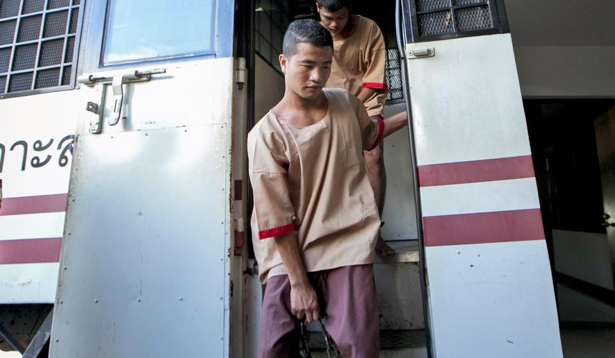 Myanmar migrants Win Zaw Htun, front, and Zaw Lin, both 22, arrive at court in Koh Samui, Thailand, Thursday, Dec. 24, 2015. A Thai court was to deliver its verdict Thursday in the murder case of two British backpackers, David Miller, 24, and Hannah Witheridge, 23, last year on the resort island of Koh Tao. The two Myanmar migrants could face the death penalty if convicted. (AP Photo/Wason Wanichakorn)