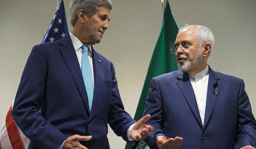 FILE - In this Sept. 26, 2015 file photo, Secretary of State John Kerry meets with Iranian Foreign Minister Mohammad Javad Zarif at United Nations headquarters. Congressional Republicans are criticizing the Obama administration over its reassurances to Iran about new visa rules. At issue is a new law tightening visa-free travel to the U.S. The measure was part of a spending bill passed by Congress last week and signed by President Barack Obama. It requires visas for citizens of Iraq, Syria, Iran and Sudan, as well as recent visitors to those countries.  (AP Photo/Craig Ruttle, File)