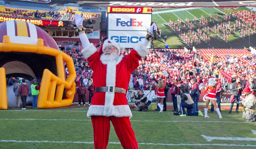 CHRISTMAS CHEER: Last season, the Washington Redskins were 4-11 before Christmas. But Saturday, quarterback Kirk Cousins (inset) leads the team into Philadelphia with a chance to win the NFC East outright for the first time since 2012, giving the organization and its fans a potential reason to celebrate. (Associated Press photographs)