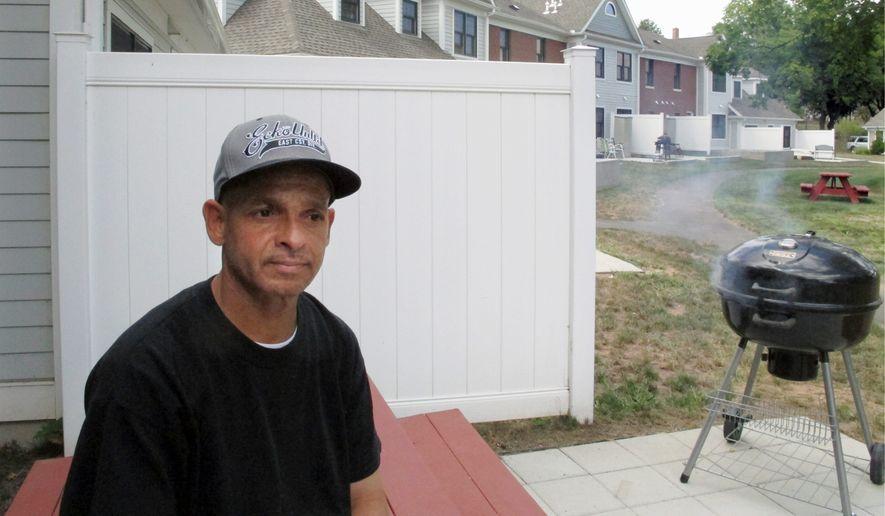 Luis Vazquez, a Navy veteran who was homeless off and on for 10 years, sits outside his home in a veterans housing complex in Newington, Connecticut. Twelve cities, three counties and one state, Virginia, say they have ended veteran homelessness altogether. Connecticut says it has ended chronic homelessness. (Associated Press)