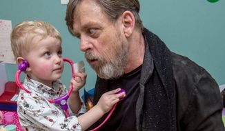 "Mark Hamill, the actor who plays Luke Skywalker in ""Star Wars"" chose to visit sick children in a London hospital this week instead of attending a promotional event for ""The Force Awakens"" (Image: Twitter @HamillHimself)"