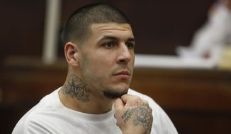 Former New England Patriots NFL football player Aaron Hernandez attends a pre-trial hearing at Suffolk Superior Court, Tuesday, Dec. 22, 2015, in Boston. Hernandez is charged with killing two Boston men in 2012 after a chance encounter at a nightclub. (AP Photo/Steven Senne, Pool)