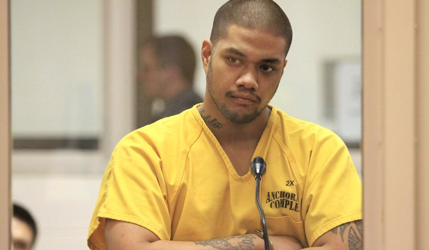 Solomon Brown Tavita listens to proceedings during his arraignment at the Anchorage Correctional Center, Thursday, Dec. 24, 2015, in Anchorage, Alaska. Tavita is charged with two counts of second-degree murder and one of drug misconduct in the deaths of 22-year-old Jeramyha Talauega and 33-year-old Robin Porter following a failed drug transaction. (AP Photo/Dan Joling)