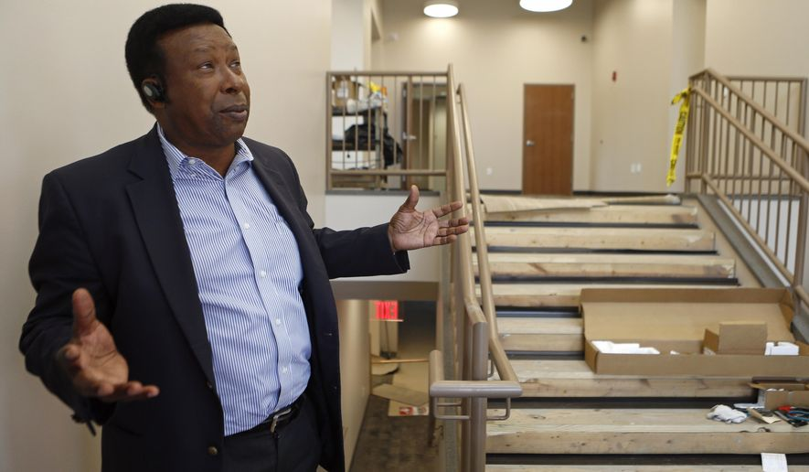 In this Nov. 25, 2015 photo, Ed Hightower gives a tour of the Mannie Jackson Center for the Humanites in Edwardsville, Ill. The once segregated school has be transformed into a community center with Hightower as its executive director. (Zia Nazami/Belleville News-Democrat via AP)