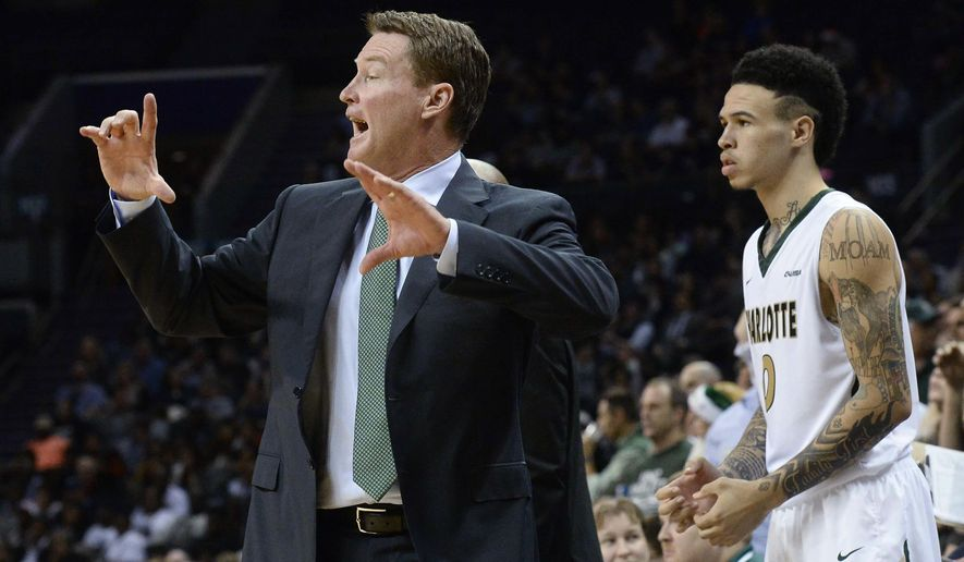Charlotte coach Mark Price instructs his team from the sideline during an NCAA college basketball game against Georgetown on Tuesday, Dec. 22, 2015, in Charlotte, N.C. Georgetown won 62-59. (Robert Lahser/The Charlotte Observer via AP)
