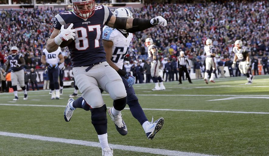 FILE - In this Sunday, Dec. 20, 2015, file photo, New England Patriots tight end Rob Gronkowski (87) catches a pass for a touchdown in front of Tennessee Titans linebacker Avery Williamson (54) in the first half of an NFL football game in Foxborough, Mass. The New York Jets play the Patriots on Sunday, Dec. 27. (AP Photo/Charles Krupa, File)