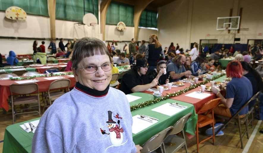 ADVANCE FOR WEEKEND EDITIONS DEC. 26-27 - In this  Dec. 12, 2015 photo, for more then 30 years Betty Riebe of Lewiston, Idaho, has been helping put together All Saints Community Dinner to give the less-fortunate a warm meal for the holidays. (Kyle Mills/Lewiston Tribune via AP) MANDATORY CREDIT