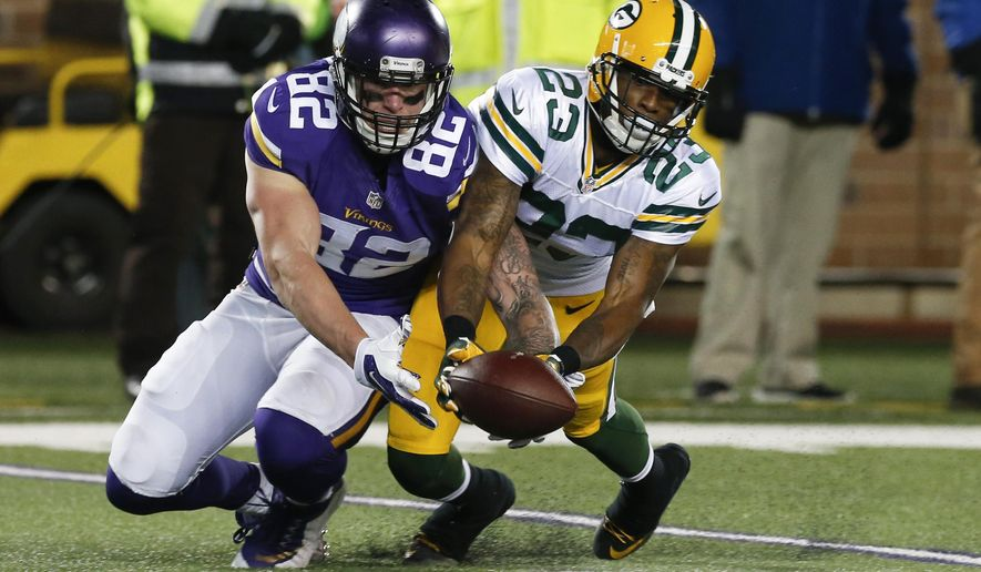 FILE - In this Sunday, Nov. 22, 2015, file photo, Green Bay Packers cornerback Damarious Randall (23) breaks up a pass to Minnesota Vikings tight end Kyle Rudolph (82) during the second half of an NFL football game in Minneapolis. The Vikings and Packers are on course to play each other in back-to-back games, in Week 17 and in the wild card round. (AP Photo/Jim Mone, File)