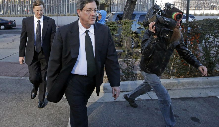FILE - In this Jan. 21, 2015, file photo, brothers of polygamous sect leader Warren Jeffs, Lyle, foreground, and Nephi, leave the federal courthouse in Salt Lake City. Federal labor lawyers say a company regularly used children from a polygamous group as unpaid workers on a southern Utah pecan farm, refuting the company's contention that the kids picked up leftover nuts with their families.  (AP Photo/Rick Bowmer, File)