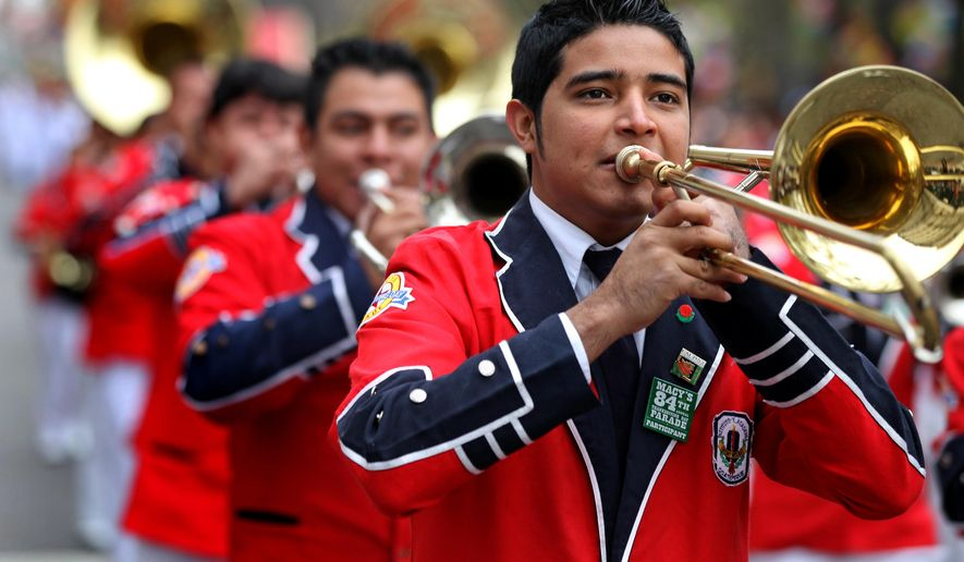 FILE - In this Thursday, Nov. 25, 2010, file photo, a member of Banda Musical Latina Pedro Molina of Guatemala perform during the Macy's Thanksgiving Day Parade in New York. The band from Guatemala has been unable to get visas to participate in the 2016 New Year's Day Rose Parade. The Tournament of Roses' music committee chairman, Richard De Jesu, says there's no word on why visas were denied for the 340-member Latin band Instituto Pedro Molina. (AP Photo/Craig Ruttle, File)