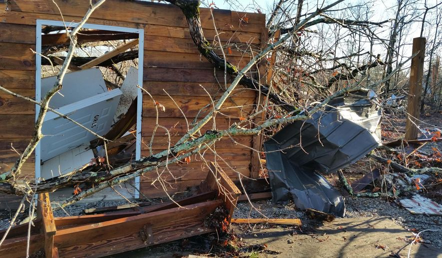 A church lies in ruins, Thursday, Dec. 24, 2015, after severe weather caused damage to several buildings in Mississippi's Benton County on Wednesday. Mississippi Emergency Management Agency said a 35-person team was out looking for two people unaccounted for in Benton County. At least six people have been killed across the country as fierce spring-like storms hit Wednesday. (AP Photo/Phillip Lucas)