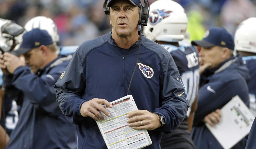 FILE - In this Sunday, Nov. 29, 2015 file photo, Tennessee Titans interim head coach Mike Mularkey watches from the scoreboard in the first half of an NFL football game against the Oakland Raiders in Nashville, Tenn. Mularkey has two games left as interim head coach of the Tennessee Titans, not that he's changed his style or approach in an attempt to win himself the job past this season. He's too busy coaching, trying only to win the next game. (AP Photo/James Kenney, File)