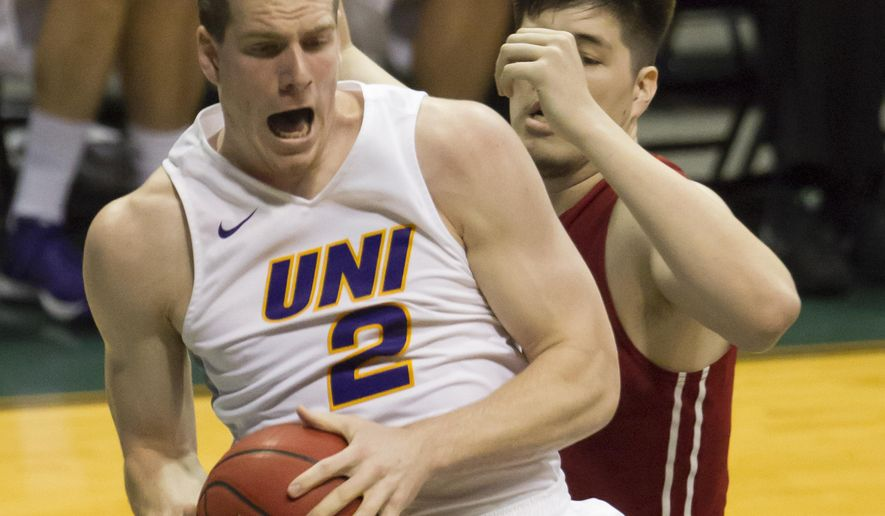 Northern Iowa forward Klint Carlson (2) controls a rebound while being defended by Washington State center Conor Clifford, right, during the first half of an NCAA college basketball game at the Diamond Head Classic, Wednesday, Dec. 23, 2015, in Honolulu. (AP Photo/Eugene Tanner)