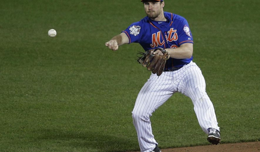 FILE - In this Sunday, Nov. 1, 2015, file photo, New York Mets second baseman Daniel Murphy throws to second on a double play on a hit by Kansas City Royals' Alcides Escobar during the third inning of Game 5 of the Major League Baseball World Series in New York. A person familiar with the negotiations says second baseman Daniel Murphy and the Washington Nationals have agreed to a three-year contract on Thursday, Dec. 24, 2015. (AP Photo/Julie Jacobson, File)
