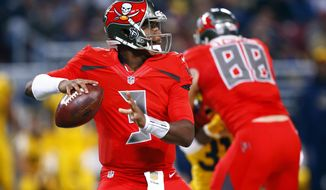 FILE - In this Dec. 17, 2015, file photo, Tampa Bay Buccaneers quarterback Jameis Winston looks to pass during the first quarter of an NFL football game against the St. Louis Rams in St. Louis. The Buccaneers play the Chicago Bears on Sunday, Dec. 27, in Tampa, Fla. (AP Photo/Billy Hurst, File)