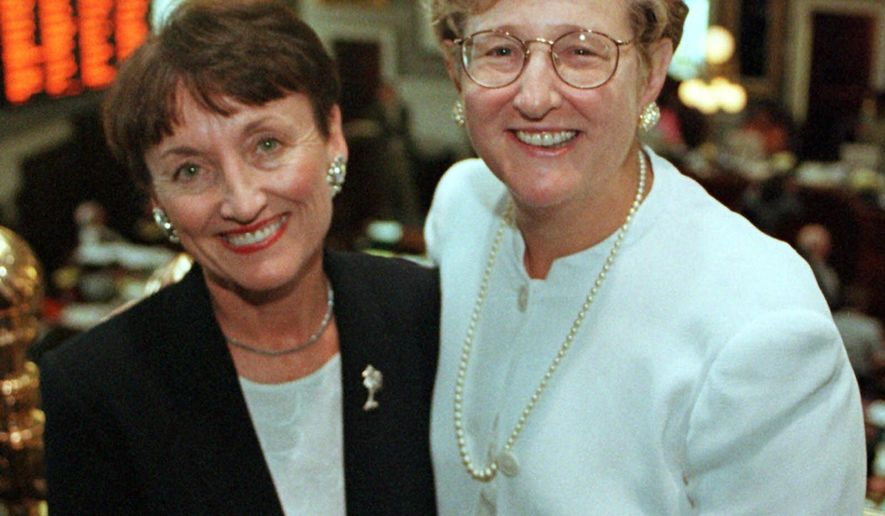 FILE - This June 2, 1999 file photo shows South Carolina Supreme Justice Jean Toal, right, the first female chief justice, and Appeals Court Judge Kaye Hearn, the first woman to be elected chief judge of the state Appeals Court in Columbia, SC. Toal is retiring at the end of the year after spending 27 years on the state Supreme Court. (AP Photo/Lou Krasky, File)