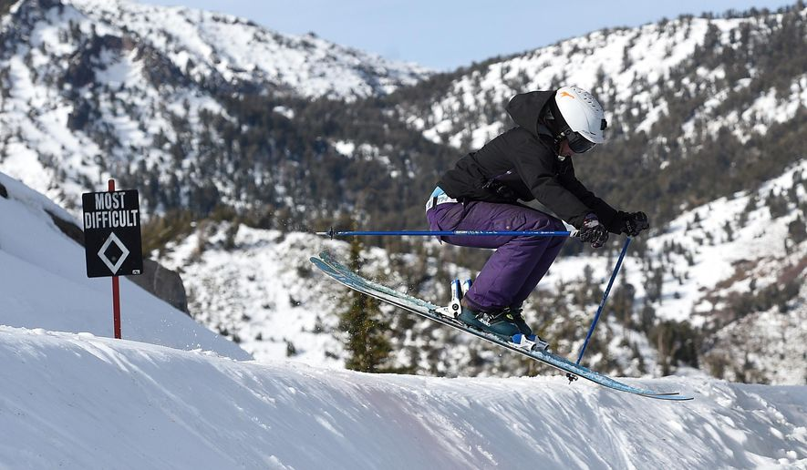In this Dec. 8, 2015 photo, Jenn Sheridan catches some air using a pair of Coalition Snow skis on Mt. Rose Ski Tahoe in Reno, Nev. (Jason Bean/The Reno Gazette-Journal via AP)  NO SALES; NEVADA APPEAL OUT; SOUTH RENO WEEKLY OUT; MANDATORY CREDIT