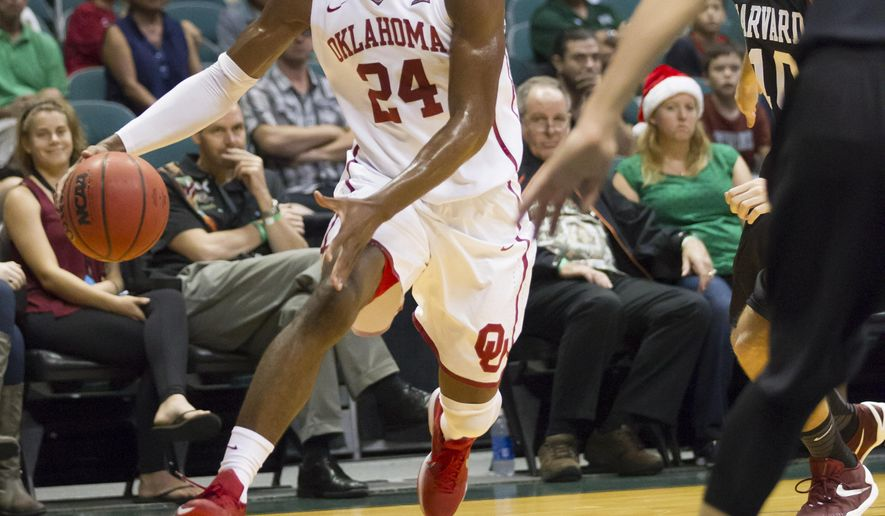 Oklahoma guard Buddy Hield (24) attempts to drive the baseline in the first half of an NCAA college basketball game against Harvard at the Diamond Head Classic, Friday, Dec. 25, 2015, in Honolulu. (AP Photo/Eugene Tanner)