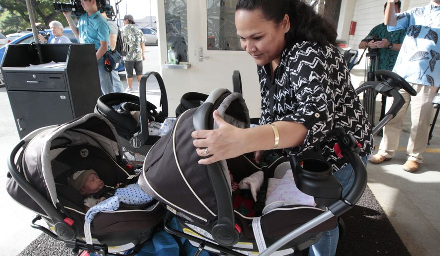 In this Dec. 24, 2015 photo, Marcie Dela Cruz prepares to take all of her quintuplets home together for the first time at Kapiolani Medical Center in Honolulu, Hawaii. The eleven-week-old Honolulu quintuplets are home in time for Christmas. The four boys and one girl were born premature on Oct. 10. Doctors expected the babies would need to remain in the hospital for up to three months. (Krystle Marcellus/The Star-Advertiser via AP) MANDATORY CREDIT