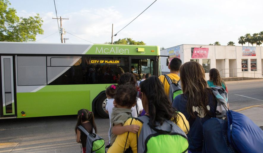 FILE - In this file photo from April 30, 2015, immigrant families, many of them mothers with children, board a bus headed to the downtown bus station in McAllen, Texas. The immigrants, mostly from Central America, had crossed the Rio Grande and were later released by Border Patrol with notices to appear before immigration judges around the country. Only two states say their National Guard operations could provide facilities to house unaccompanied immigrant children following a request for options from the government. Most states say they aren't set up to handle that kind of housing or they lack the facilities. Ohio also says it's concerned about government oversight of the program, pointing to a case of labor trafficking at a large egg farm in the state earlier this year. (AP Photo/Seth Robbins, File)