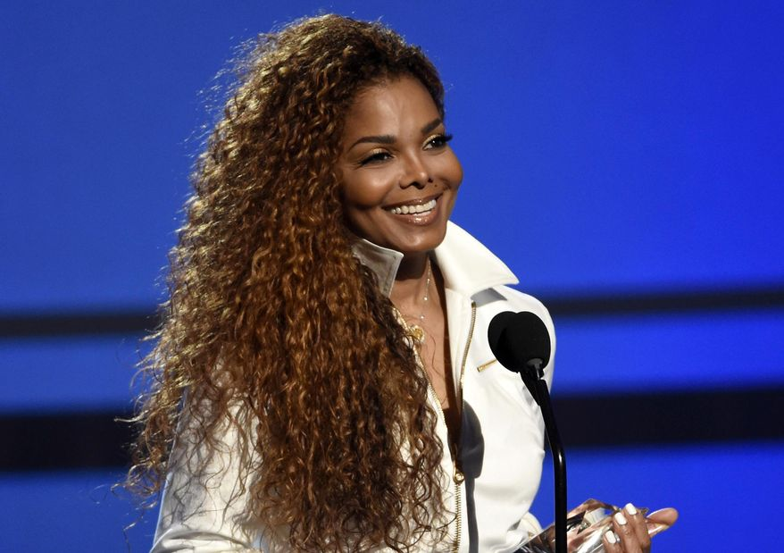 """FILE - In this June 28, 2015, file photo, Janet Jackson accepts the ultimate icon: music dance visual award at the BET Awards in Los Angeles. Jackson announced Thursday, Dec. 24, 2015, that she was postponing all upcoming dates on her """"Unbreakable"""" world tour until the spring so that she could have surgery for an undisclosed medical condition. (Photo by Chris Pizzello/Invision/AP, File)"""