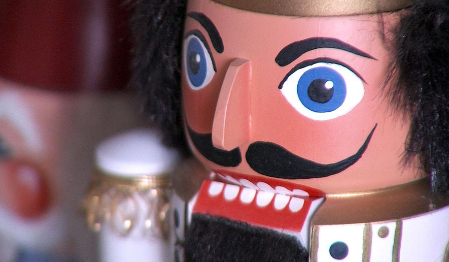This Dec. 23, 2015 photo shows one of the many nutcrackers John Bruce's friends have painted for him, at Bruce's shop in Draper, Utah. Bruce, a Utah retiree who learned woodworking from his father, is putting his skills to work in the nearly lost art of handmade nutcrackers. (Ray Boone/KSL TV, Deseret News via AP) MANDATORY CREDIT