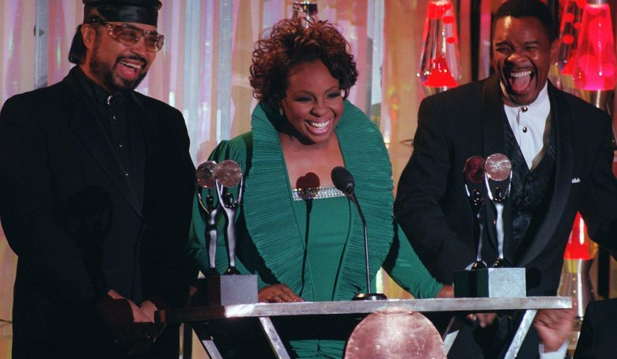 FILE- In this Jan. 17, 1996, file photo, Gladys Knight, center, William Guest, left, and Merald Knight take the stage as they are inducted into the Rock and Roll Hall of Fame during ceremonies in New York. William Guest, a member of Gladys Knight and the Pips, has died. He was 74. Guest's daughter, Monique Guest, said her father died Thursday, Dec. 24, 2015. (AP Photo/Mark Lennihan, File)
