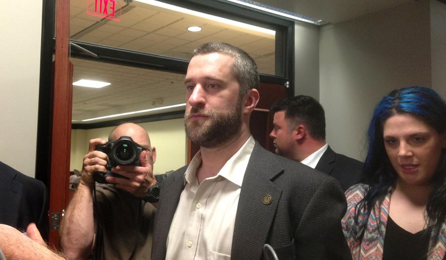 "FILE - In this May 29, 2015, file photo, television actor Dustin Diamond, center, leaves court in Port Washington, Wisc., after being convicted of two misdemeanors stemming from a barroom fight on Christmas Day 2014. Jail time is on hold for the former ""Saved by the Bell"" actor while he appeals his sentence for an altercation at a bar in Wisconsin. Diamond was supposed to begin serving a four-month sentence last weekend at county jail north of Milwaukee. On Thursday, July 2, 2015, a judge in Ozaukee County Circuit Court stayed Diamond's sentence pending his appeal. (AP Photo/Dana Ferguson, File)"