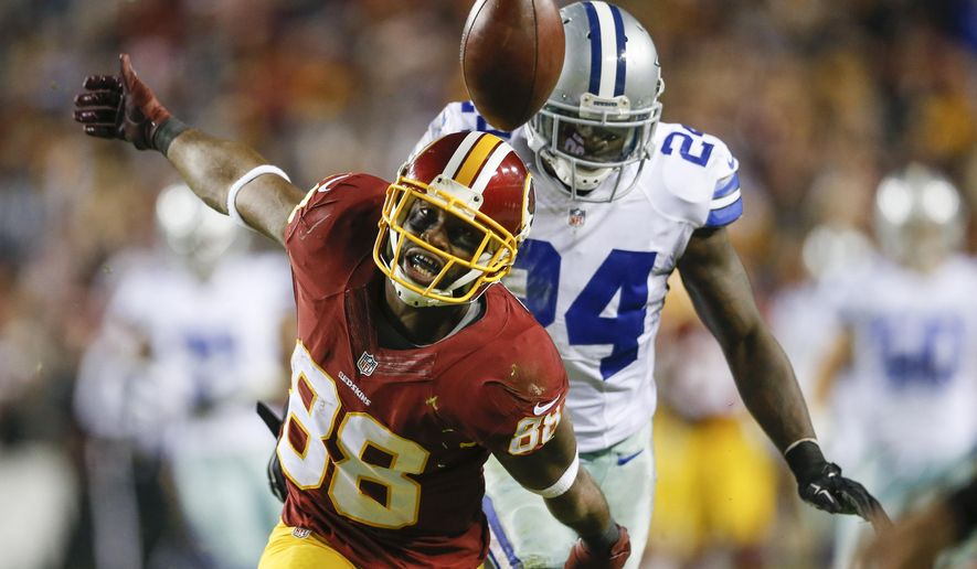 FILE - In this Dec. 7, 2015, file photo, Washington Redskins wide receiver Pierre Garcon (88) watches a pass get away from him under pressure from Dallas Cowboys cornerback Morris Claiborne (24) during the second half of an NFL football game in Landover, Md. The 2015 NFL football season has been marked by mediocrity, not parity. From the porous offensive lines to the suspect quarterbacking and poor tackling, from the inconsistent officiating to the multitude of key injuries, the season has been filled with the unwatchable. (AP Photo/Patrick Semansky, File)