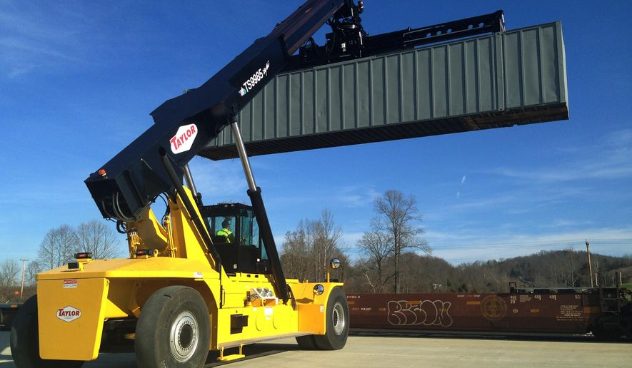 In this Dec. 10, 2015 photo, Robert Sublett, of Parsec, W.Va., practices using a lift to move a container onto a train car at the Heartland Intermodal Gateway terminal in Prichard, W.Va. Halfway between a Virginia seaside port and one of the busiest U.S. rail yards in Chicago, the new railroad facility has opened in Appalachia as officials look to drum up business in West Virginia and potentially diversify an economy that has relied on coal for decades. (AP Photo/John Raby)