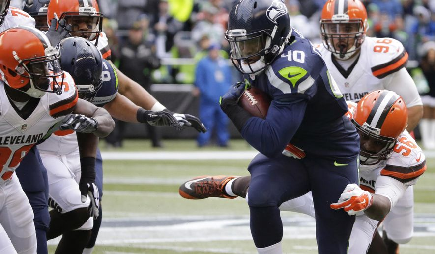 FILE - In this Dec. 20, 2015, file photo, Seattle Seahawks' Derrick Coleman runs with the ball against the Cleveland Browns in the first half of an NFL football game, in Seattle. The Seahawks play the St. Louis Rams on Sunday, Dec. 27, in Seattle. (AP Photo/Ted S. Warren, File)