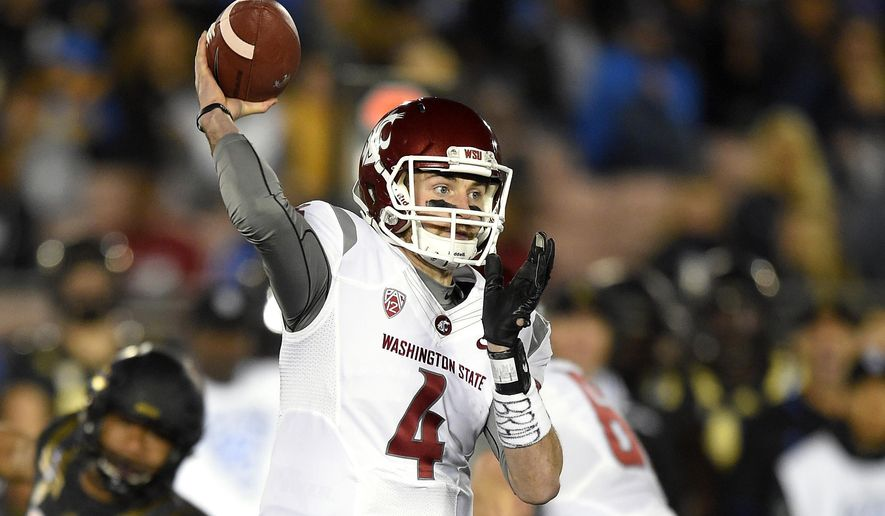 FILE - In this Saturday, Nov. 14, 2015 file photo, Washington State quarterback Luke Falk passes during the first half of an NCAA college football game against UCLA in Pasadena, Calif. Falk leads the nation's top-ranked passing offense (397 yards per game) with a nation-leading 4,266 yards and 36 TDs with eight interceptions. (AP Photo/Mark J. Terrill, File)