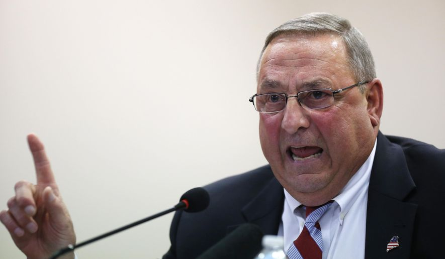 FILE - In this October 2015 file photo, Republican Gov. Paul LePage speaks at a town hall meeting in Auburn, Maine. The governor's intervention to get Democratic Speaker of the House Mark Eves fired from his job at a charter school roiled the Statehouse, led to a lawsuit and cast a cloud over the upcoming legislative session. The drama that pitted LePage against Eves was voted top story of the year by The Associated Press and its member affiliates in Maine. (AP Photo/Robert F. Bukaty, File)