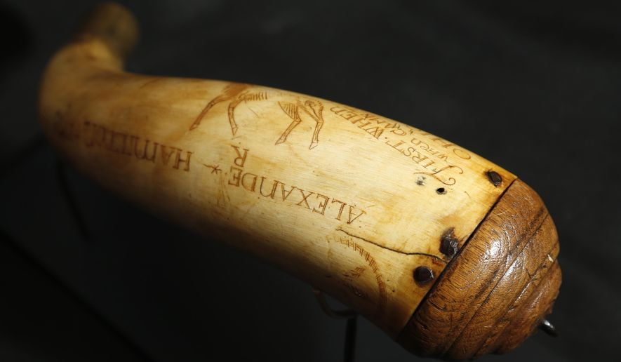 In a Tuesday, Dec. 15, 2015, photo, a horn believed to have been owned by Alexander Hamilton is photographed at Antique NJ in Closter, N.J. The horn will be put up for auction on Jan. 11, 2016. (AP Photo/Julio Cortez)
