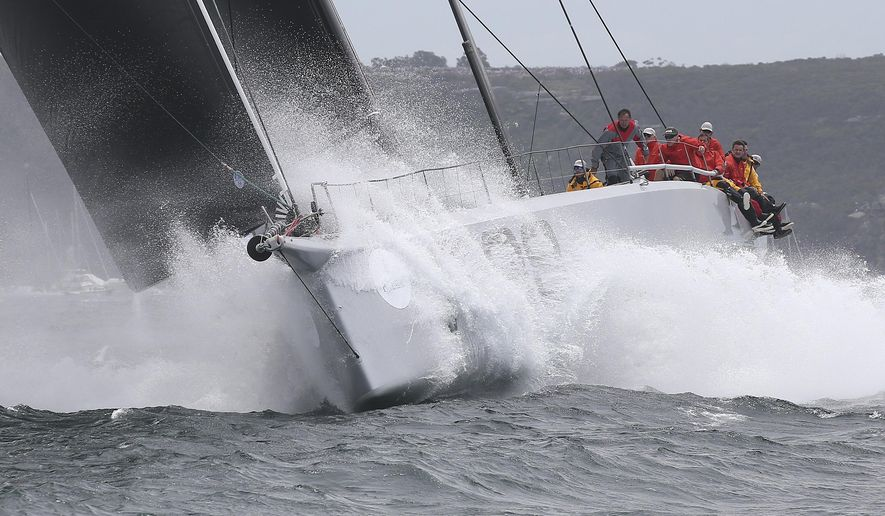U.S. yacht Rambler crashes through a wave as she sails out of the heads during the start of the Sydney Hobart yacht race in Sydney Saturday, Dec. 26, 2015. The 628-nautical-mile race started in Sydney Harbour and is expected to end two to three days later in Hobart, the capital of the island state of Tasmania. (AP Photo/Rob Griffith)