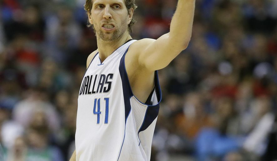 Dallas Mavericks forward Dirk Nowitzki (41) acknowledges fans before an NBA basketball game against the Chicago Bulls Saturday, Dec. 26, 2015, in Dallas. (AP Photo/LM Otero)