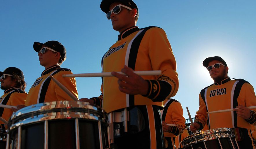 FOR RELEASE SATURDAY, DECEMBER 26, 2015, AT 12:01 A.M. CST. - The Hawkeye Marching Band performs for fans outside Kinnick Stadium prior to Iowa's game against Pittsburgh on Saturday, Sept. 19, 2015. Just two days after the University of Iowa football team received word it was heading to the Rose Bowl, Hawkeye Marching Band director Kevin Kastens boarded a flight to Southern California. Kastens was part of a university delegation that made a three-day site visit to Pasadena, where he drove the Tournament of Roses Parade route and toured the stadium ahead of the Hawkeyes' first trip to the prestigious New Year's Day bowl in 25 years. (David Scrivner/Iowa City Press-Citizen via AP)