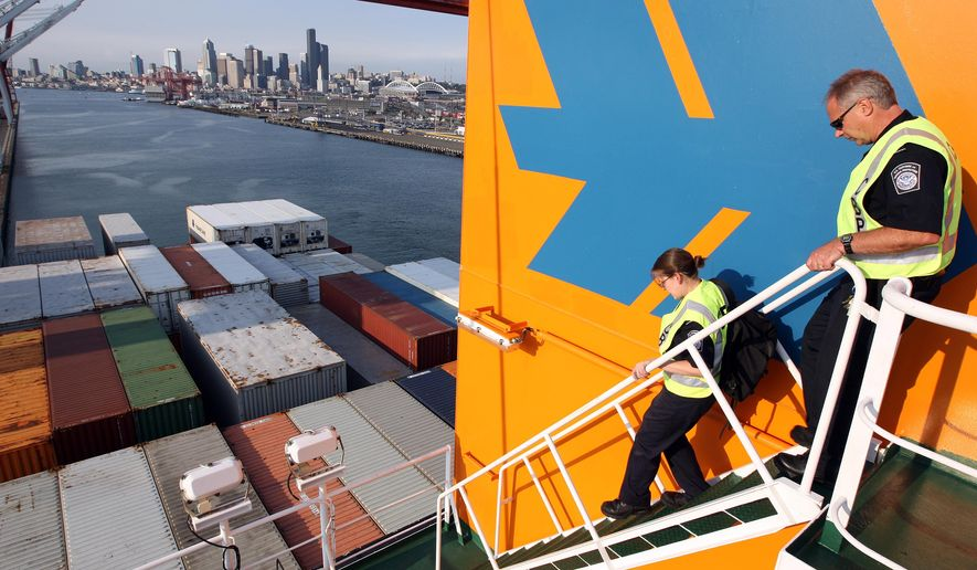 FILE - In this Aug. 8, 2008, file photo, specialists with the U.S. Customs and Border Protection agency look over a vessel in Harbor Island in Seattle to inspect for any signs of Asian gypsy moths after the ship arrived from high risk ports. Oregon agriculture officials propose to spray about 8,000 acres over the Portland area next spring to kill leaf-eating gypsy moths. Washington state agriculture officials will decide soon whether to propose spraying a biological pesticide over 10,500 acres in Western Washington. (AP Photo/Kevin P. Casey, File)
