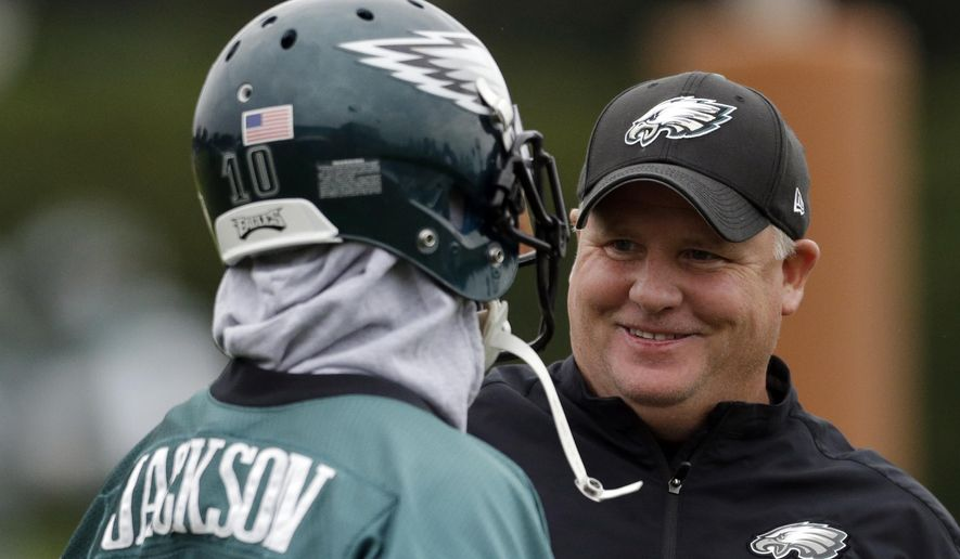 "FILE - In this Sept. 16, 2013, file photo, Philadelphia Eagles wide receiver DeSean Jackson, left, meets with head coach Chip Kelly during practice at the NFL football team's training facility, in Philadelphia. Jackson had his the best season with the Eagles playing under Kelly in 2013. Yet, Kelly cut Jackson a few months after the season. There's one side of the football part of his decision. The other was his contract. But the main reason Jackson was let go was he didn't fit the ""culture"" Kelly was building in Philadelphia. (AP Photo/Matt Rourke, File)"