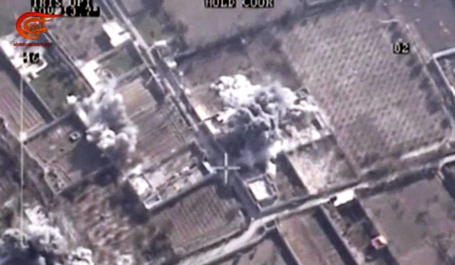 This image made from video made available on Saturday, Dec. 26, 2015, by Al-Mayadeen, government-controlled Syrian Television, which has been verified and is consistent with other AP reporting shows,drone footage allegedly showing Syrian army airstrikes targeting Zahran Alloush, the head of the Army of Islam group near Damascus, Syria. (Al-Mayadeen via AP video)