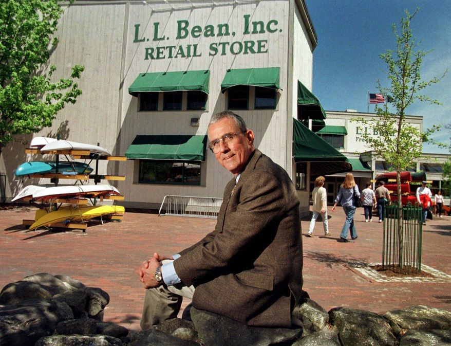 FILE - In this May 1999 file photo, Leon A. Gorman sits outside one of the company's stores in Freeport, Maine. Gorman, a grandson of L.L. Bean, who led a modernization of his family's outdoor clothing and gear retail business after the founder's death, died Thursday, Sept. 3, 2015, at his home in Yarmouth, Me. He was 80. Gorman's death was one of the notable deaths in Maine, in 2015. (AP Photo/Robert F. Bukaty, File)