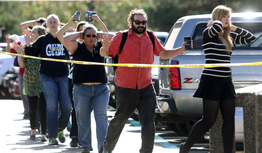 Pro-gun advocates say massacres such as the one that occurred at Umpqua Community College in Roseburg, Oregon, on Oct. 1, could be stopped sooner if students were allowed to carry firearms on campus. (The News-Review via Associated Press)