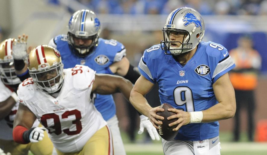 Detroit Lions quarterback Matthew Stafford (9) scrambles away from San Francisco 49ers nose tackle Ian Williams (93) during the first half of an NFL football game, Sunday, Dec. 27, 2015, in Detroit. (AP Photo/Jose Juarez)
