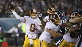 Washington Redskins' Kirk Cousins in action in the second half of an NFL football game against the Philadelphia Eagles, Saturday, Dec. 26, 2015, in Philadelphia.  (AP Photo/Matt Rourke)